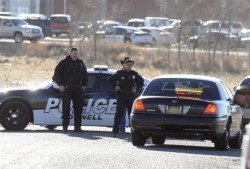 Law enforcement personnel set up a perimeter following an early morning shooting at Berrendo Middle School in Roswell